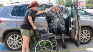Double leg amputee getting out of a car